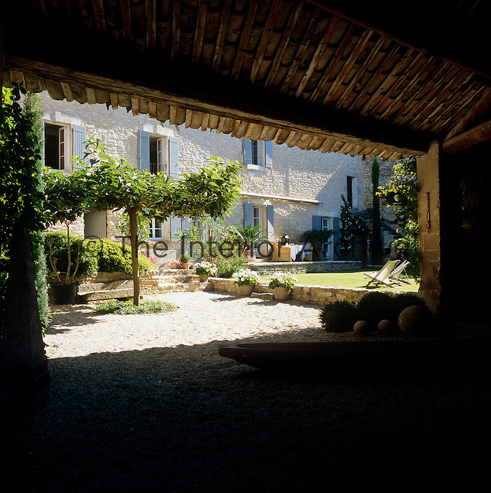 The courtyard garden seen from the converted hangar formerly used for housing farm machinery