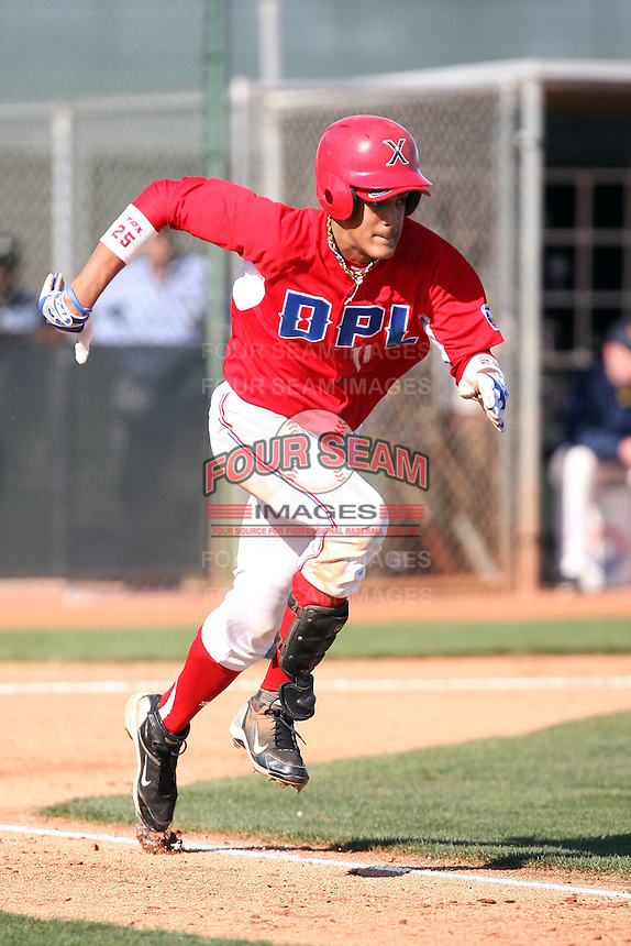 Ronald Guzman #11 of the Dominican Prospect League All-stars plays against the Langley (British Columbia) Blaze in an exhibition game at Surprise Recreational Complex, the Texas Rangers minor league complex, on March 22, 2011 in Surprise, Arizona..Photo by:  Bill Mitchell/Four Seam Images