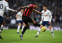 30th November 2019; Tottenham Hotspur Stadium, London, England; English Premier League Football, Tottenham Hotspur versus AFC Bournemouth; Steve Cook of Bournemouth clears the ball under pressure  from Dele Alli of Tottenham Hotspur - Strictly Editorial Use Only. No use with unauthorized audio, video, data, fixture lists, club/league logos or 'live' services. Online in-match use limited to 120 images, no video emulation. No use in betting, games or single club/league/player publications