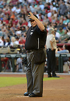 Umpire Wally Bell signals for four baseballs during a game between the Arizona Diamondbacks and Washington Nationals at Chase Field on September 28, 2013 in Phoenix, Arizona.  Washington defeated Arizona 2-0.  (Mike Janes/Four Seam Images)