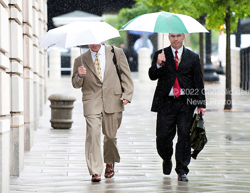 Former New York Yankee trainer Brian McNamee, left, arrives at U.S. District Court in Washington, D.C. with an unidentified attorney on Monday, May 14, 2012 to testifiy in the Roger Clemens perjury trial..Credit: Ron Sachs / CNP.(RESTRICTION: NO New York or New Jersey Newspapers or newspapers within a 75 mile radius of New York City)