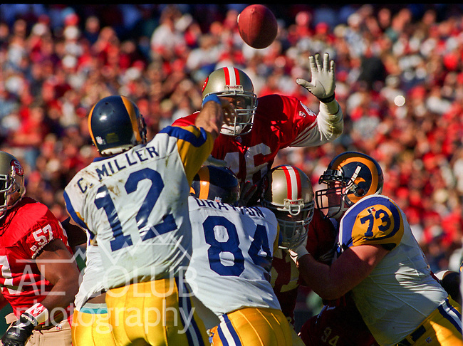 San Francisco 49ers vs. St. Louis Rams at Candlestick Park Sunday, November 26, 1995.  49ers beat Rams  41-13.  San Francisco 49ers defensive back Tim McDonald (46) blocks St. Louis Rams quarterback Chris Miller (12) pass.