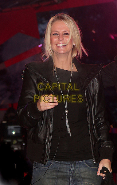 ULRIKA JONSON .during the final of Celebrity Big Brother 2009 at Elstree Studios, Borehamwood, Herts, England, January 23rd 2009. .half length black leather jacket silver tassel necklace hand winner top Johnson Jonsson Jonnson.CAP/ROS.©Steve Ross/Capital Pictures