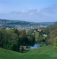 View from Prior Park, a villa set on a hill overlooking the city of Bath with a Palladian bridge straddling a lake in its grounds below