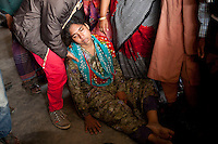 Bangladeshi woman mourn grieves for her relatives  after a river ferry carrying more than 100 passengers capsized in the River Padma Sunday after being hit by a cargo vessel at Paturia, in Manikganj district, about 80 kilometers  northwest of Dhaka, Bangladesh. Feb. 22, 2015