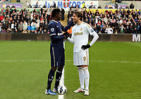Pictured L-R: Emmanuel Adebayor of Tottenham greets Michu of Swansea before kick off. Saturday 30 March 2013<br /> Re: Barclay's Premier League, Swansea City FC v Tottenham Hotspur at the Liberty Stadium, south Wales.