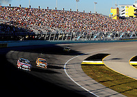 Nov. 16, 2008; Homestead, FL, USA; NASCAR Sprint Cup Series driver Carl Edwards (99) races alongside teammate Matt Kenseth (17) during the Ford 400 at Homestead Miami Speedway. Mandatory Credit: Mark J. Rebilas-