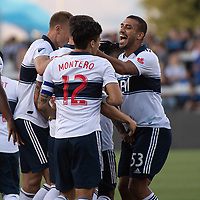 SAN JOSE, CA - AUGUST 24: Fredy Montero  #12 and Ali Adnan  #53 of the Vancouver Whitecaps celebrate a goal. during a game between Vancouver Whitecaps FC and San Jose Earthquakes at Avaya Stadium on August 24, 2019 in San Jose, California.
