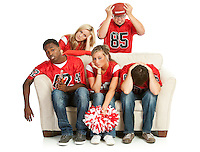 Extensive series, of male and female fans of American football.  Watching from a couch, tailgating, and more...