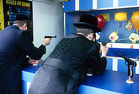 Two Orthodox Jewish boys play a game at Astroland Amusement Park during Passover.