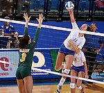 BROOKINGS, SD - SEPTEMBER 30:  Wagner Larson #11 from South Dakota State winds up for a kill past Emily Minnick #3 from North Dakota State in the fourth game of their match Tuesday night at Frost Arena in Brookings. (Photo/Dave Eggen/Inertia)