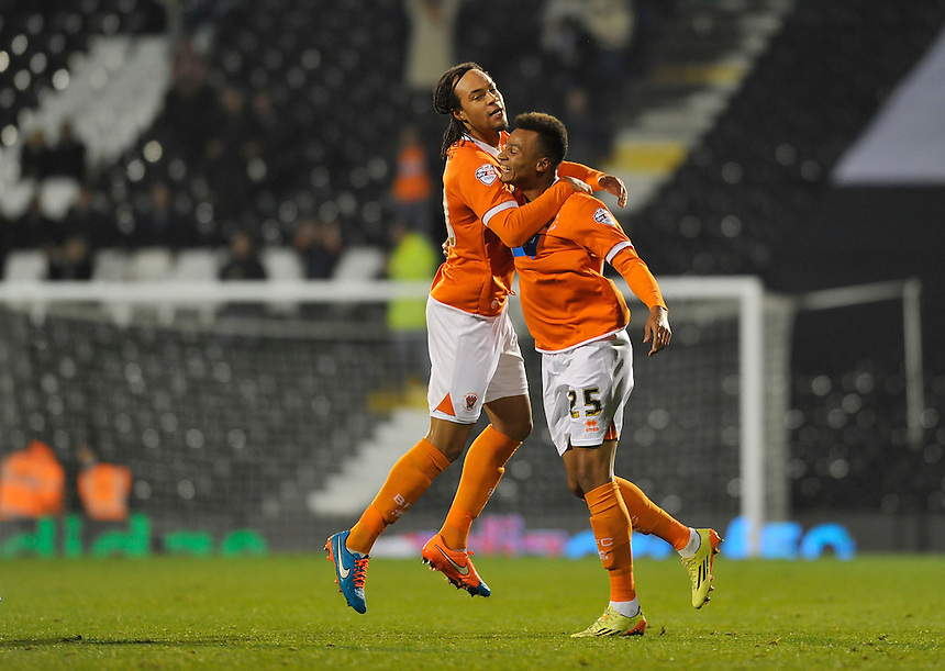 Blackpool's Jacob Murphy celebrates scoring his sides second goal with Charles Dunne<br /> <br /> Photographer Ashley Western/CameraSport<br /> <br /> Football - The Football League Sky Bet Championship - Fulham v Blackpool - Wednesday 5th November 2014 - Craven Cottage - London<br /> <br /> &copy; CameraSport - 43 Linden Ave. Countesthorpe. Leicester. England. LE8 5PG - Tel: +44 (0) 116 277 4147 - admin@camerasport.com - www.camerasport.com