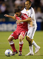 Chicago Fire midfielder Stephen King (33) and LA Galaxy midfielder Peter Vagenas (8) battle for a ball during a MLS match. The Chicago Fire defeated the LA Galaxy 1-0 at Home Depot Center stadium in Carson, California on Thursday, August 21, 2008.