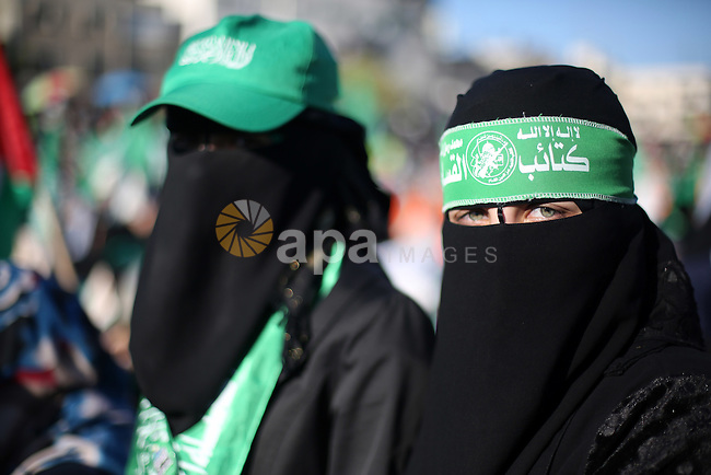 Palestinian women supporting Hamas movement take part in a rally to show solidarity with al-Aqsa mosque in Gaza city on Dec. 06, 2015. Israeli forces on Sunday detained a Palestinian schoolgirl who was allegedly carrying a knife near the Wadi Helwa area of occupied East Jerusalem Silwan neighborhood. Photo by Mohammed Talatene