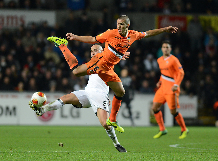 Swansea City's Jonjo Shelvey collides with Valencia's Oriol Romeu<br /> <br /> Photo by Ian Cook/CameraSport<br /> <br /> Football - UEFA Europa League Group A - Swansea City v Valencia - Thursday 28th November 2013 - The Liberty Stadium - Swansea<br /> <br /> &copy; CameraSport - 43 Linden Ave. Countesthorpe. Leicester. England. LE8 5PG - Tel: +44 (0) 116 277 4147 - admin@camerasport.com - www.camerasport.com