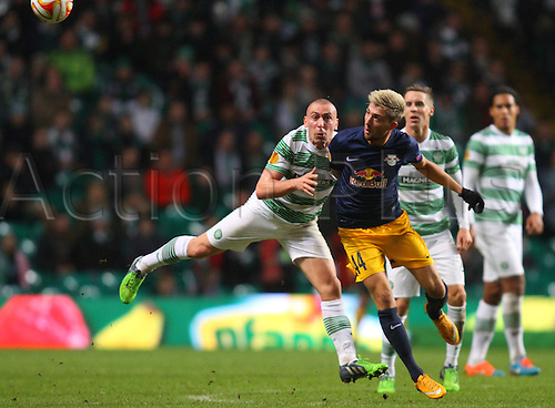 27.11.2014. Glasgow, Scotland. Europa League Group Stages Qualifying Round. Celtic versus FC Red Bull Salzburg. Scott Brown and Kevin Kampl challenge in midfield