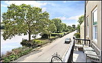 BNPS.co.uk (01202 558833)<br /> Pic: Riverhomes/BNPS<br /> <br /> Looking downriver - the small square garden comes with the house..<br /> <br /> Buy a bit of London Pride...Red Lion House was once the pub attached to the famous Fullers brewery in Chiswick.<br /> <br /> Yours for &pound;8million - Beer fans with deep pockets will want to get their hands on this famous former pub - as it's all but attached to the historic Fullers brewery by the Thames in Chiswick.<br /> <br /> Red Lion House, on exclusive Chiswick Mall in west London, was originally built as a pub more than 300 years ago for Thomas Mawson's brewery, which went on to become Fuller's in 1845.<br /> <br /> Back in the 18th and 19th centuries, the pub would have been a bustling hive of activity with boat crews and carters as regular customers, but it is now a tranquil and elegant riverside home.<br /> <br /> It does have an incredible wine cellar with a barrelled ceiling that is perfect for hosting parties if the new owners want to play publican.