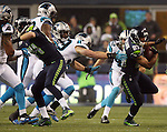 Seattle Seahawks  wide receiver Doug Baldwin (89)  runs through the tackle of Carolina Panthers Luke Kuechly (59) in the NFC Western Division Playoffs at CenturyLink Field  on January 10, 2015 in Seattle, Washington. The Seahawks beat the Panthers 31-17. ©2015. Jim Bryant Photo. All Rights Reserved.