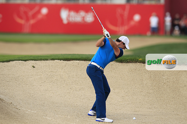 Rory McIlroy (NIR) plays his 2nd shot from a fairway bunker on the 17th hole during Sunday's Final Round of the Abu Dhabi HSBC Golf Championship 2015 held at the Abu Dhabi Golf Course, United Arab Emirates. 18th January 2015.<br /> Picture: Eoin Clarke www.golffile.ie
