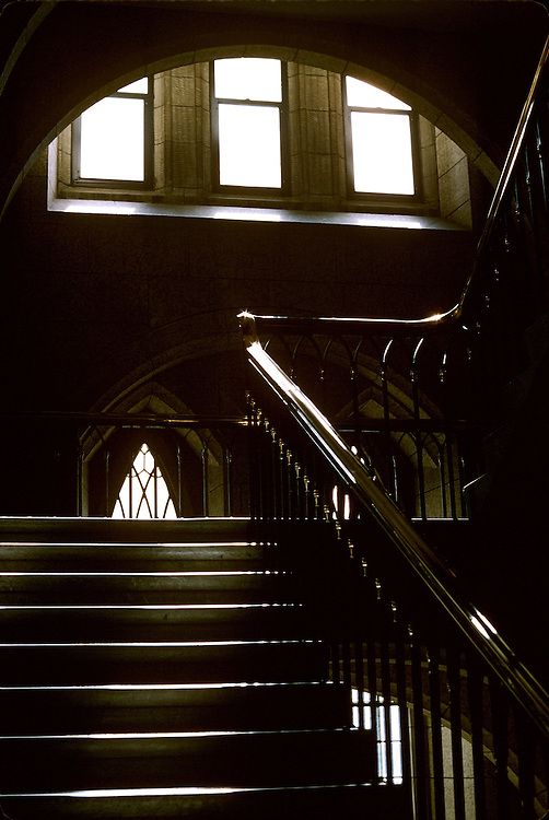 Sunlight filtering through window onto steps and brass railing in Houses of Parliament, Ottawa, Ontario.