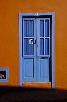 Blue door against orange wall.Tenerife, Canary Islands