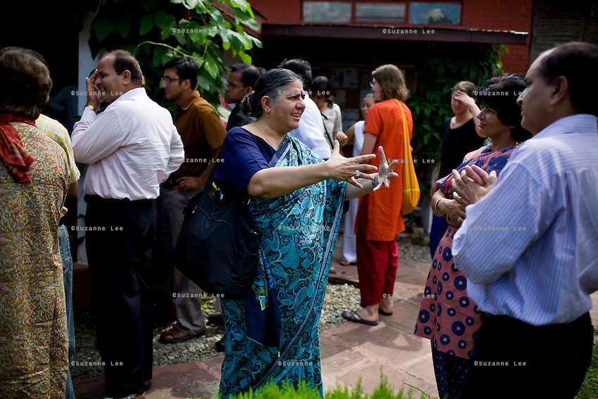 Dr. Vandana Shiva (center) discusses issues and solutions during lunch break with the attendees of the Regional Conference for Climate Change in Himalaya in the Navdanya conference room in Dehradun, Uttarakhand, India, on 6th September 2009...Dr. Vandana Shiva, the founder of Navdanya Foundation and Bijavidyapeeth, is a physicist turned environmentalist who campaigns against genetically modified food and teaches farmers to rely on indigenous farming methods.. .Photo by Suzanne Lee / For The National