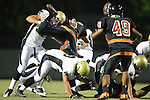 Beverly Hills, CA 09/23/11 - Patrick Nollinger (Beverly Hills #9), Chris Whitehead (Peninsula #36), Max McHugh (Peninsula #59) in action during the Peninsula-Beverly Hills Varsity football game.