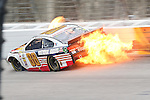 Sprint Cup Series driver Dale Earnhardt Jr. (88) wrecks his car during the Nascar Sprint Cup Series Texas 500 race at Texas Motor Speedway in Fort Worth,Texas.
