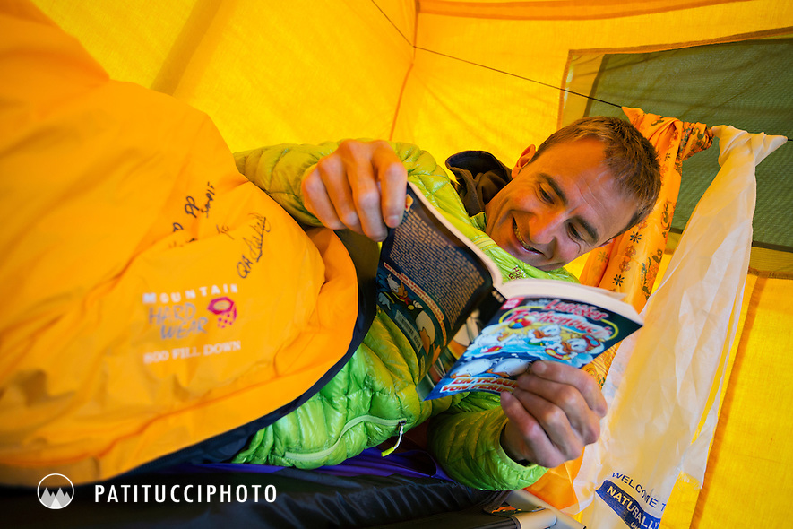 Ueli Steck returned to Nepal and the Annapurna south face in 2013 which he climbed solo, without oxygen, in one 28 hour alpine push, via a new route. The trip was his third attempt to climb the 8000 meter peak. Ueli reading a comic book in basecamp.