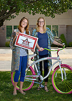 NWA Democrat-Gazette/BEN GOFF &bull; @NWABENGOFF<br /> Malorie Marrs (left), manager for Fundraising and special events with the American Diabetes Association - Northwest Arkansas, and Natalie Burchit, director of the American Diabetes Association - Northwest Arkansas, pose for a photo with the bike they received as a donation from Boomchickapop on Friday July 24, 2015 at the American Diabetes Association office in Bentonville.