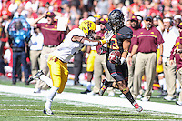College Park, MD - October 15, 2016: Maryland Terrapins running back Lorenzo Harrison (23) avoids getting pushed out of bounds by a Minnesota Golden Gophers defender during game between Minnesota and Maryland at  Capital One Field at Maryland Stadium in College Park, MD.  (Photo by Elliott Brown/Media Images International)