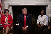 United States President Donald J. Trump listens during the one year celebration of the Pledge to America's Workers at the White House in Washington D.C., U.S. on July 25, 2019.<br /> <br /> Credit: Stefani Reynolds / CNP