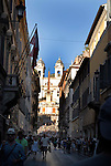 View along Via Condotti towards the Spanish Steps and the Church of Trinita dei Monti in the Campo Marzio district of Rome.
