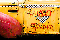 Door of an aged Tijuana Taxi cab.