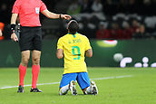 27th March 2018, Olympiastadion, Berlin, Germany; International Football Friendly, Germany versus Brazil; Gabriel Jésus (Brazil) prays as he scores the only goal of the game and the referee instructs him to get back into formation for the restart