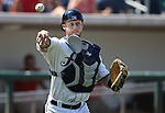 Reno Aces' Dan Rohlfing makes the throw to first on a dropped third strike against the Tacoma Rainiers at Greater Nevada Field in Reno, Nev., on Sunday, Aug. 28, 2016. <br />