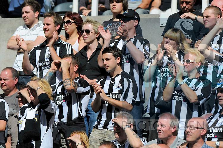 Newcastle United fans watching their team take on Aston Villa.