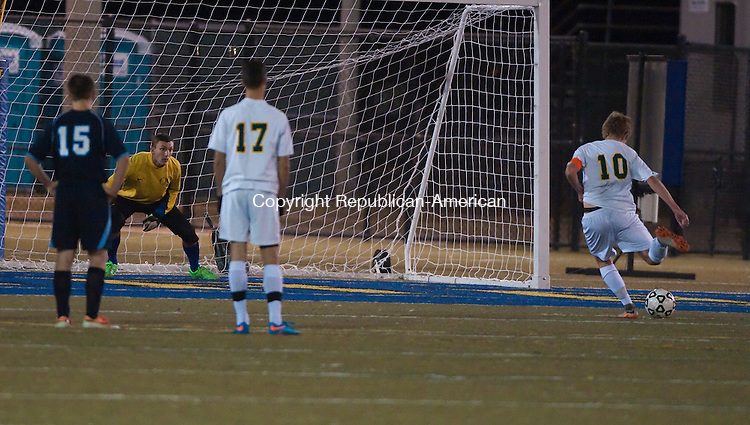 WATERBURY, CT--- -102615JS19---Holy Cross'  Sean Harnish (10) fires a penalty kick past Oxford's William Richter in the first half of their game Monday at Municipal Stadium in Waterbury. <br />  Jim Shannon Republican-American