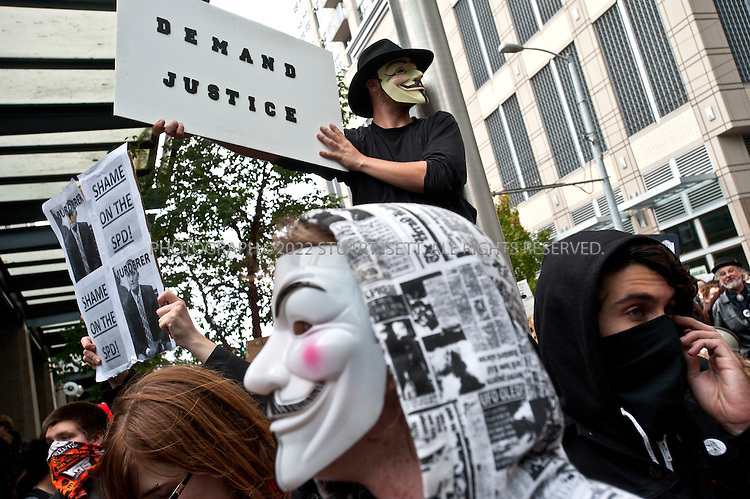 10/22/2011--Seattle, WA, USA..Occupy Seattle protesters stop outside a police station during a protest march in downtown Seattle.Occupy Seattle, a spin off of the Occupy Wall Street protests in New York City, joined an anti-police brutality march in downtown Seattle with over 500 protesters, including a few black masked anarchists and other radicals. ..The Occupy Seattle protest has attempted to set up a base in Seattle's Westlake Park in the heart of the city but the Seattle Police Department has arrested anyone attempting to set up tents...©2011 Stuart Isett. All rights reserved.