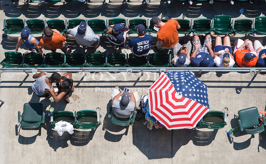 4 July 2010: A couple steals a kiss during the seventh inning stretch during the Seattle Mariners at Detroit Tigers Major League Baseball game at Comerica Park, in Detroit, Michigan. Seattle won 8-1.