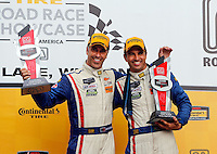 Joao Barbosa and Christian Fittipaldi in victory lane, IMSA Tudor Series Race, Road America, Elkhart Lake, WI, August 2014.  (Photo by Brian Cleary/ www.bcpix.com )
