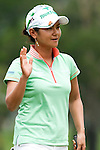 CHON BURI, THAILAND - FEBRUARY 17:  Ai Miyazato of Japan acknowledges to the crowd on the 5th hole during day one of the LPGA Thailand at Siam Country Club on February 17, 2011 in Chon Buri, Thailand.  Photo by Victor Fraile / The Power of Sport Images