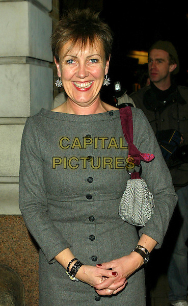 AGGIE McKENZIE  .Channel 4 25th Anniversary party at the Quarter Club, London, England..October 30th, 2007.four half length grey gray dress beads bracelets buttons purse bag .CAP/FEE.©FEE/Capital Pictures.