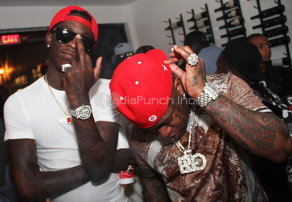 BEVERLY HILLS, CA - JUNE 28, 2014<br /> Young Thugga &amp; Birdman attend the Young Money Official BET Awards Pre Party at Philippe Chow June 28, 2014 in Beverly Hills, CA<br /> &copy; Walik Goshorn / MediaPunch