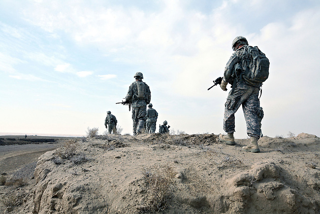 Soldiers with Company A, 2nd Battalion, 2nd Infantry Regiment patrol alongside a wadi near the village of Mama Karez in Maiwand district, Kandahar province, Afghanistan. The soldiers have recently built a new camp near the village in an effort to disrupt Taliban activity in the area. Dec. 29, 2008.