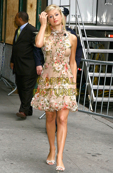 PARIS HILTON.At the David Letterman Late Show, Ed Sullivan Theatre, New York City, USA,.April 28th 2005..full length walking brown beige floral print patterned dress flowers touching face hair.Ref: IW.www.capitalpictures.com.sales@capitalpictures.com.©Ian Wilson/Capital Pictures.