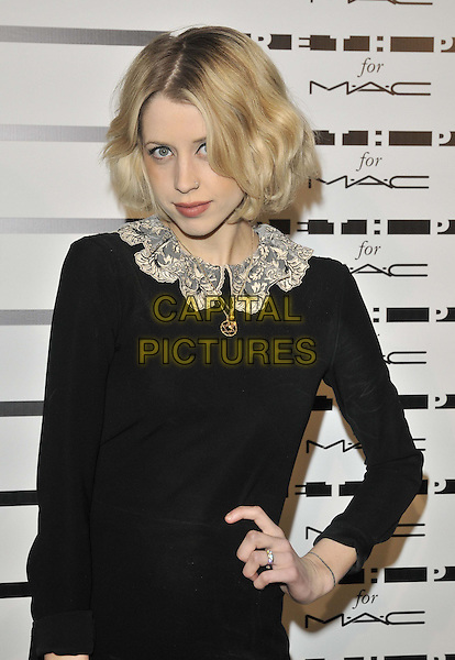 Peaches Geldof<br /> attended the launch of the Gareth Pugh for MAC Cosmetics colour collaboration, P3, University of Westminster, Marylebone Rd., London, England, UK, 8th December 2011.<br /> half length black dress collar  lace gold necklace bob hand on hip long sleeve <br /> CAP/CAN<br /> &copy;Can Nguyen/Capital Pictures