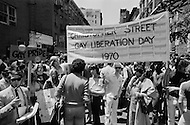 28 Jun 1970, Manhattan, New York City, New York State, USA. Participants in New York's first Gay Pride parade gather at Christopher Street and Sixth Avenue in Greenwich Village. Some hold signs and banners celebrating their pride.