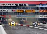 Apr 20, 2018; Baytown, TX, USA; NHRA funny car driver Jonnie Lindberg (left) and Del Worsham during qualifying for the Springnationals at Royal Purple Raceway. Mandatory Credit: Mark J. Rebilas-USA TODAY Sports