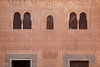 Stucco facade in the Patio of the Gilded Room, between the Mexuar and the Gilded Room or Cuarto Dorado in the Comares Palace, with intricately carved wall with latticed windows, Alhambra Palace, Granada, Andalusia, Southern Spain. It was built under Mohammed V in the 14th century. The Alhambra was begun in the 11th century as a castle, and in the 13th and 14th centuries served as the royal palace of the Nasrid sultans. The huge complex contains the Alcazaba, Nasrid palaces, gardens and Generalife. Granada was listed as a UNESCO World Heritage Site in 1984. Picture by Manuel Cohen